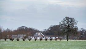 Niederländische ländliche Winterlandschaft mit Gutshaus Stockbild