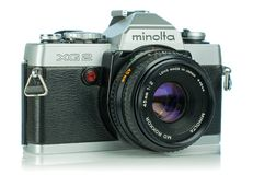 A Minolta XG2 35mm analog film camera. NIEDERSACHSEN, GERMANY April 9, 2019: A Minolta XG2 35mm analog film camera on a white background royalty free stock image