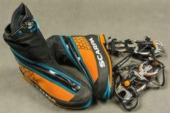 The presentation mountaineering boots Scarpa Phantom Tech and automatic crampons Black Diamond Sabretooth Pro. Stock Photos