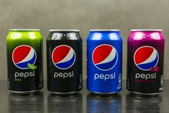 Cans with different types of Pepsi: original, wild cherry, lime and max. royalty free stock photo