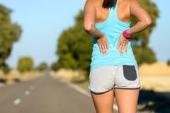 Niedrige hintere Sportverletzung und -schmerz Stockbilder