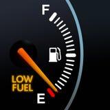 Niedrige Kraftstoffanzeige Stockbilder