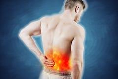Niedrigere rückseitige Schmerz Stockfotos
