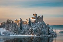 Niedzica Castle during a frosty evening, Poland. Beautiful view of Niedzica Castle during a frosty evening, Poland royalty free stock image