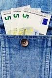 Niektóre euro pieniądze notatki w cajg kurtce wkładać do kieszeni Obraz Royalty Free