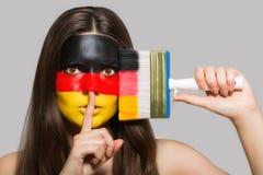 Niemiec flaga malująca na twarzy Zdjęcia Royalty Free