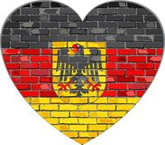 Niemiec flaga na ściana z cegieł w kierowym kształcie Obraz Royalty Free