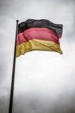 Niemiec flaga na maszcie Fotografia Royalty Free
