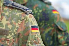 Niemiec flaga na niemiec mundurze Fotografia Stock