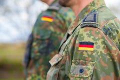Niemiec flaga na niemiec mundurze Obraz Royalty Free