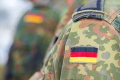 Niemiec flaga na niemiec mundurze Zdjęcia Stock