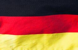 Niemiec flaga w wiatrowym zakończeniu fotografia royalty free