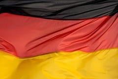 Niemiec flaga w wiatrze Obrazy Royalty Free