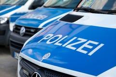 Niemieccy samochodów policyjnych stojaki na lotnisku Obrazy Royalty Free