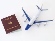 Niemiecki dziecko paszport z samolotem odizolowywał białego tło Obraz Stock