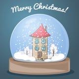 Śnieżna kula ziemska z domem Zdjęcia Royalty Free