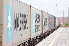 Good container train drives through trainstation. NIENBURG / GERMANY - SEPTEMBER 09, 2012: a good container train drives through trainstation Royalty Free Stock Image