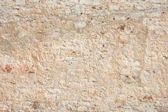 Nieociosana kamienna ściana jako tło Zdjęcie Stock