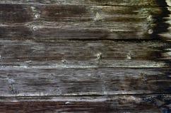 Nieociosany ciemny drewno deski tło lub tekstura zdjęcie stock