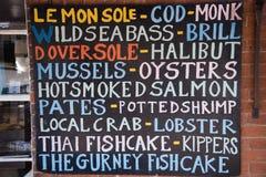 Nieociosany colourful ryba i shellfish sklepu znak Zdjęcie Stock