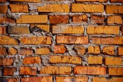 Nieociosany pomarańczowy ściana z cegieł, tło/ Obraz Royalty Free