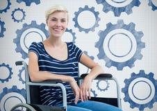 Niepełnosprawna kobieta w wózku inwalidzkim z położenia cog przekładniami zdjęcia royalty free