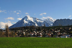 Niesen summit. Part of the village of Thun in front of Niesen summit stock photo