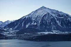Niesen Swiss Alpine peak and lake view near Thun lake in winter Stock Image