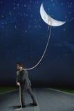 Niesie księżyc Obrazy Royalty Free