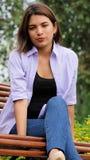 Nieszczęśliwy dziewczyna młodziena obsiadanie Na ławce Obraz Royalty Free