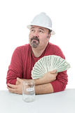 Nieszczęśliwy pracownik budowlany trzyma podatki Fotografia Royalty Free