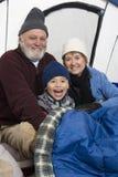 Nieto y abuelos en tienda Foto de archivo