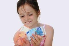 Nieuw dollarbroodje in heupzak van versleten jeansclose-up Stock Fotografie