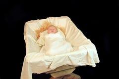 Nieuw - geboren Baby Jesus in een Trog Stock Fotografie
