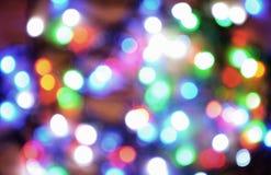 Nieuw-jaar elektrische slinger op een houten achtergrond Heldere bollen o Royalty-vrije Stock Foto
