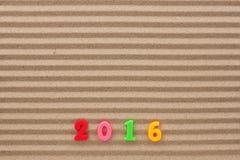 Nieuw jaar 2016 geschreven in het zand Royalty-vrije Stock Afbeelding