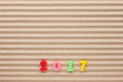 Nieuw jaar 2017 geschreven in het zand Stock Afbeelding