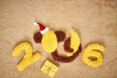 Nieuw jaar 2016 Kerstmis Grappige Aap met banaan Stock Foto's
