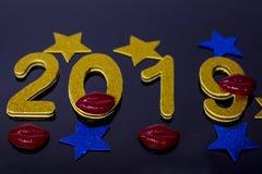 Nieuw jaar` s ontwerp Nummer 2019, kuslippen stock foto
