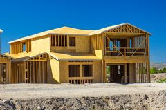 Nieuw Twee Verhaalhuis in aanbouw Stock Afbeeldingen