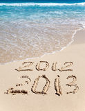 Nieuwe 2013. De golfwassen van een inschrijving 2012 Stock Foto