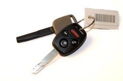 Nieuwe auto en bediendesleutels met markering Stock Foto's