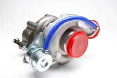 Nieuwe die turbocompressor op witte achtergrond wordt geïsoleerd royalty-vrije stock afbeelding