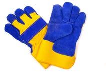 Nieuwe, dikke, blauwe en gele industriële het werkhandschoenen Stock Foto