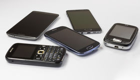 Nieuwe en oude mobiele telefoons Stock Foto's