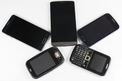 Nieuwe en oude mobiele telefoons stock afbeeldingen