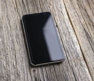 Nieuwe iPhone X 10 op een houten achtergrond, studioschot Royalty-vrije Stock Fotografie