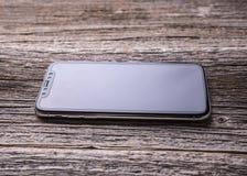 Nieuwe iPhone X 10 op een houten achtergrond, studioschot Stock Afbeelding