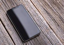 Nieuwe iPhone X 10 op een houten achtergrond, studioschot royalty-vrije stock foto's