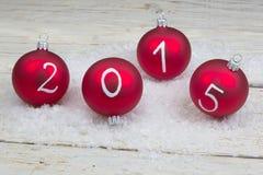 2015 Nieuwe jaartekst op Kerstmissnuisterijen Stock Afbeeldingen